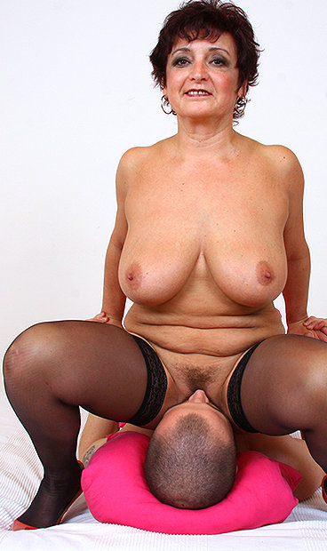 Kinky grandma wears pump boots and toys herself 5
